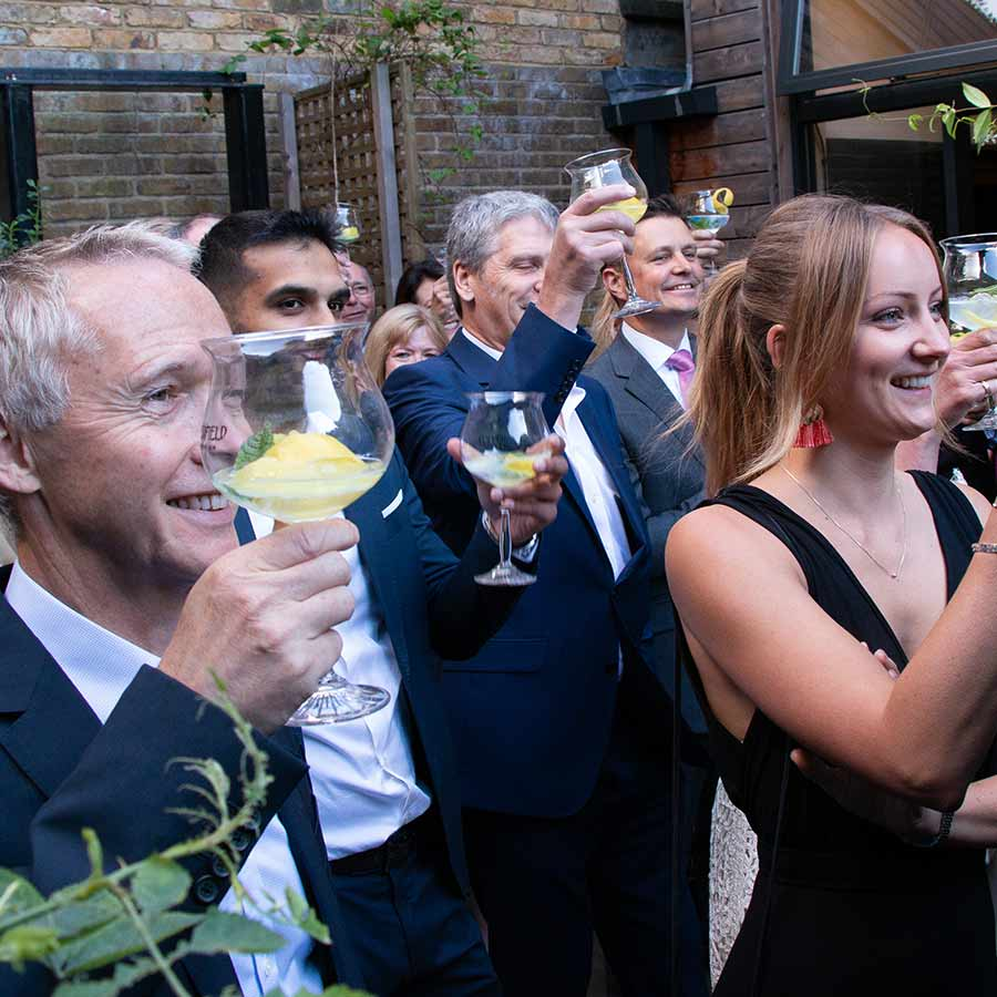 Guests toasting to the launch of The Surrey Copper Distillery in London - part of my corporate photography package