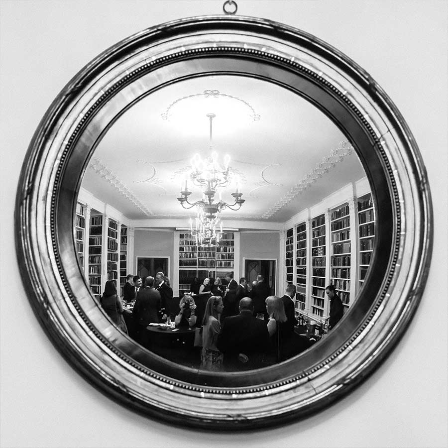 Reflection of event in a round mirror